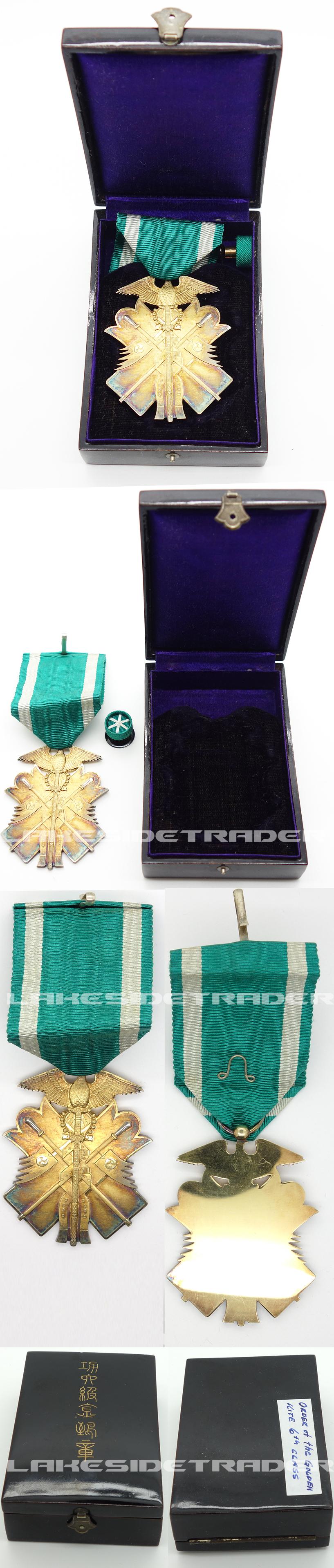 Cased Order of the Golden Kite 6th Class w Rosette