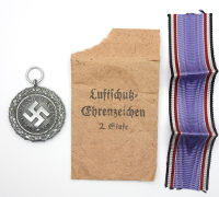 2nd Class Luftshutz Medal with issue packet.