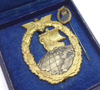 Cased Auxiliary Cruiser Badge and Miniature